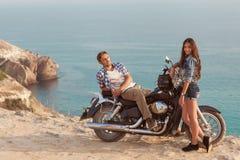 Biker man and girl royalty free stock photo