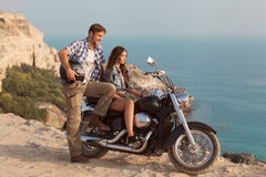 Biker man and girl Stock Photography