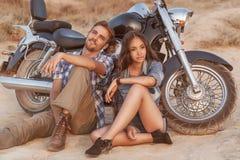 Biker man and girl stock photos