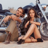 Biker man and girl sits Royalty Free Stock Photos