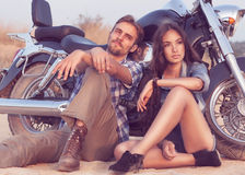 Biker man and girl sits. Happy young love couple on scooter enjoying themselves on trip Stock Images