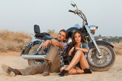 Biker man and girl sits Stock Photography