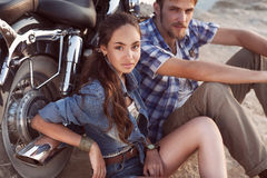 Biker man and girl sits Royalty Free Stock Photo