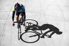 Biker. A man riding his bike with an interesting shadow Royalty Free Stock Image