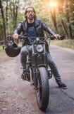 Biker man sitting on his motorcycle Stock Photo
