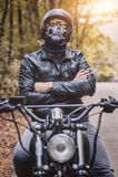 Biker man sitting on his motorcycle Royalty Free Stock Photos