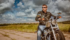 Biker on a motorcycle royalty free stock photo