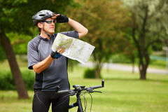 Biker with map stock photo