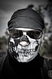 Biker with Mask. Biker wearing a skull mask and glasses Stock Photo