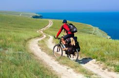 Biker on meadow royalty free stock photo