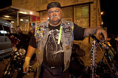 A biker, Mississippi. A biker stood next to his motorbike in Clarkesdale, Mississippi Stock Photography