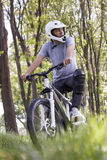 Biker in motion. Mountain biker in the forest Stock Photos
