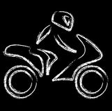A biker on a motorbike Stock Photography