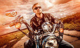 Biker on a motorcycle stock images