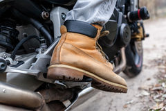 Biker on motorcycle, close-up view on legs. Stock Photography