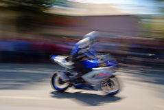 Biker with a motorcycle in motion blur Royalty Free Stock Images