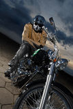 Biker on a motorcyle Stock Photo