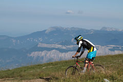 Biker in a mountain landscape Stock Image