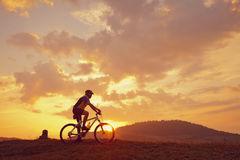 Biker mountain sun clouds Royalty Free Stock Images