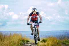 Biker on the mountain top Royalty Free Stock Image