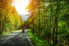 Biker on mountainous road Stock Image