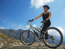 Biker on mountains with copy space royalty free stock photography