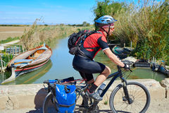 Biker MTB cycle tourism with panniers in Spain Royalty Free Stock Photo