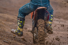 Biker and mud. Biker accelerating with lots of mud Stock Images