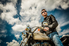 Free Biker On A Motorcycle Royalty Free Stock Photos - 37670428