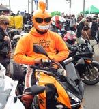 Biker in orange costume Royalty Free Stock Images