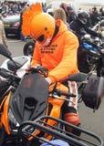 Biker in orange costume Stock Photo
