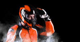 Biker in orange equipment Stock Images