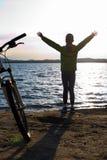 Biker person silhouette. Happy girl near bike Stock Photo