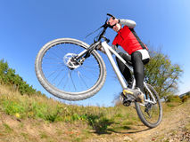 Biker photographed fisheye. Cyclist riding a mountain bike - pictures of fisheye stock images