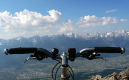 Biker POV. Point of view over a mountainbike handlebar Royalty Free Stock Photography