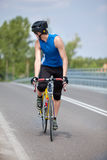 Biker race bike looking behind Stock Image