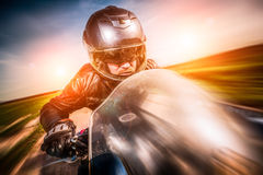 Biker racing on the road Royalty Free Stock Photography