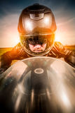 Biker racing on the road. Biker in helmet and leather jacket racing on the road Royalty Free Stock Photography