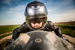 Biker racing on the road Royalty Free Stock Image