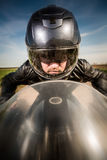 Biker racing on the road Royalty Free Stock Images
