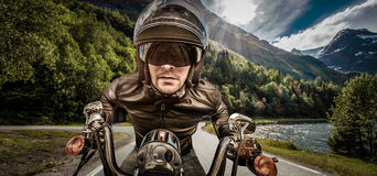 Biker racing on the road Royalty Free Stock Photo