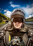 Biker racing on the road Royalty Free Stock Photos