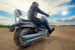 Biker racing on the road on a motorcycle Royalty Free Stock Photos
