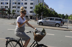 BIKER READS TEXTMESSAGES OR EMAILS. Copenhagen /Denmark - 18.June 2017. Biker reads text message or emails on iphone or smartphone biker reads something on phone stock photo