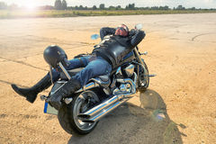 Biker resting on a motorcycle. Royalty Free Stock Images