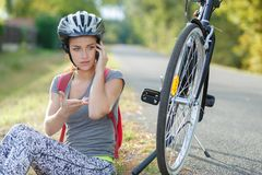 Biker resting to make call Stock Photography