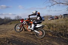 Biker Rides The Top Of Earthen The Hill MX Tracks Royalty Free Stock Images