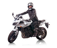 Biker rides white motorcycle Royalty Free Stock Images