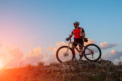 Biker riding on bicycle in mountains Royalty Free Stock Photos