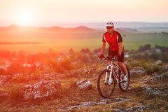 Biker riding on bicycle in mountains Royalty Free Stock Photo